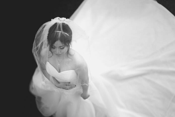Indonesian Bride in wedding dress before ceremony in black and white