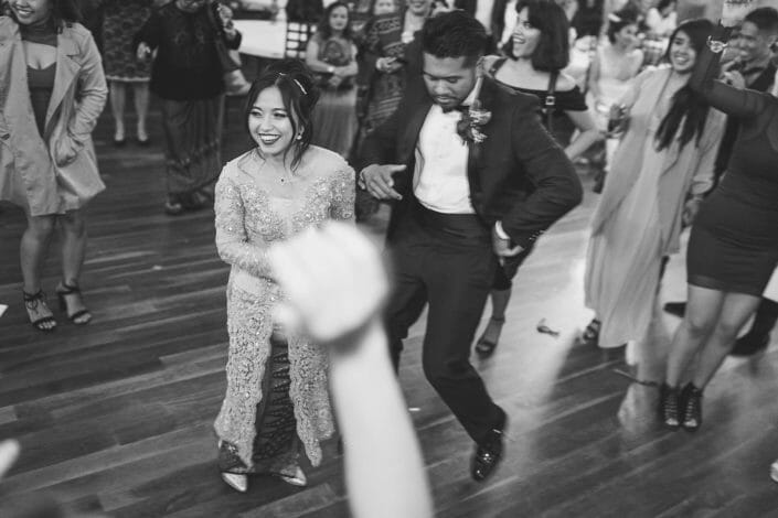 Candid Dancing at reception of Bride and Groom