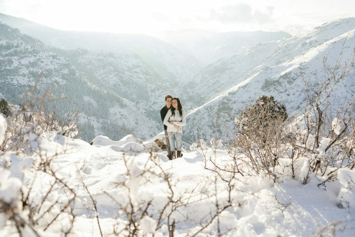 Outdoor Winter Engagement in snow at Lookout Mountain Colorado